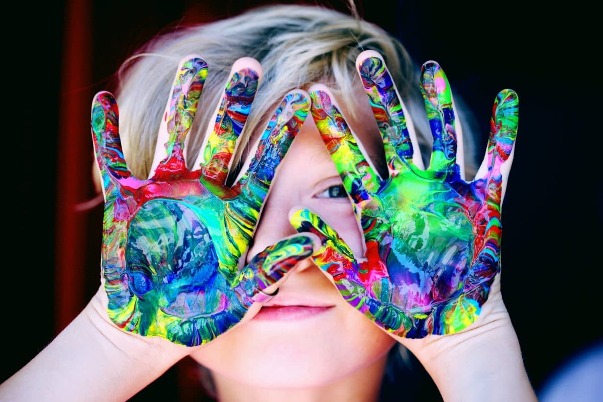 Child with paint all over their hands