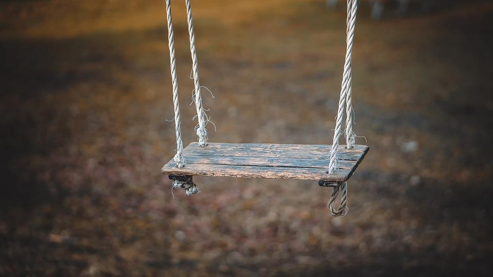 Empty swing in playground